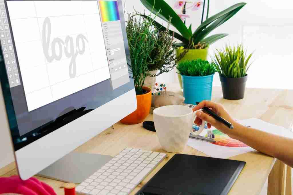 graphic designer sitting at computer; blog post on dog trainer logo design